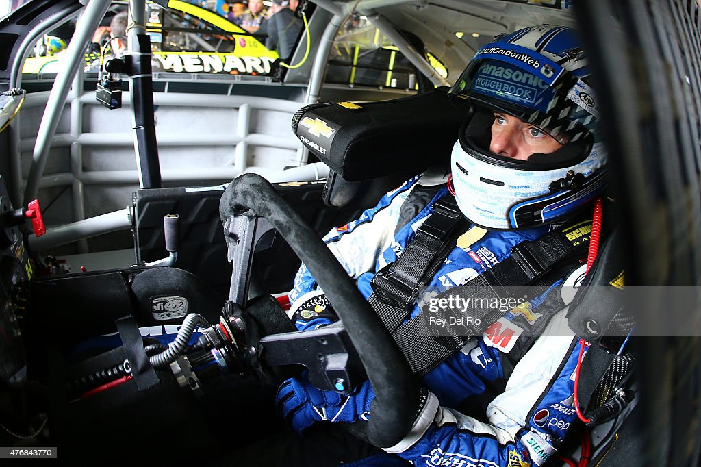 Jeff Gordon driver of the PANASONIC Chevrolet sits in his car during practice for the NASCAR Sprint Cup Series Quicken Loans 400 at Michigan...