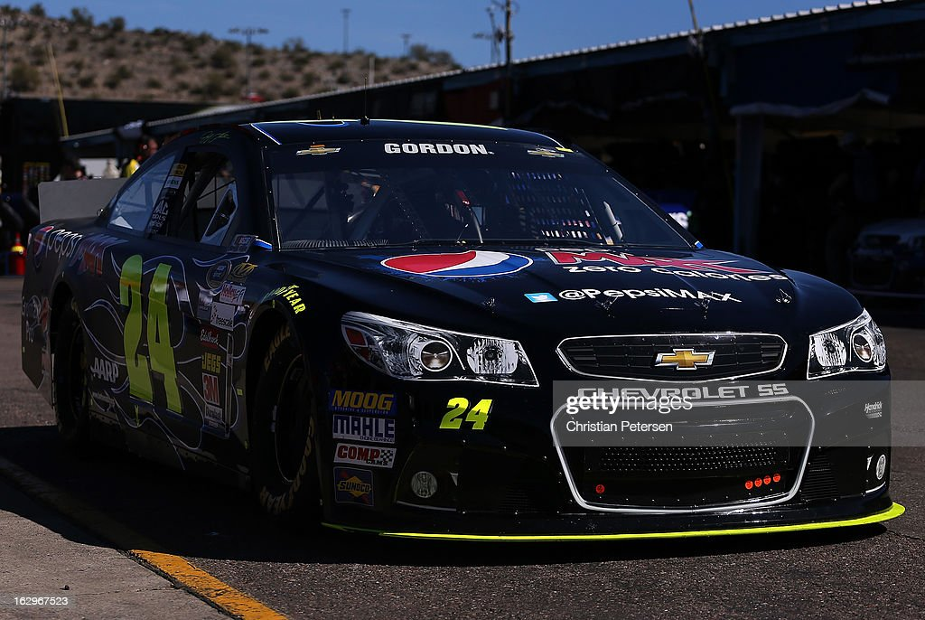 <a gi-track='captionPersonalityLinkClicked' href=/galleries/search?phrase=Jeff+Gordon&family=editorial&specificpeople=171491 ng-click='$event.stopPropagation()'>Jeff Gordon</a>, driver of the #24 Pepsi Max Chevrolet, drives through the garage area during practice for the NASCAR Sprint Cup Series Fresh Fit 500 at Phoenix International Raceway on March 2, 2013 in Avondale, Arizona.