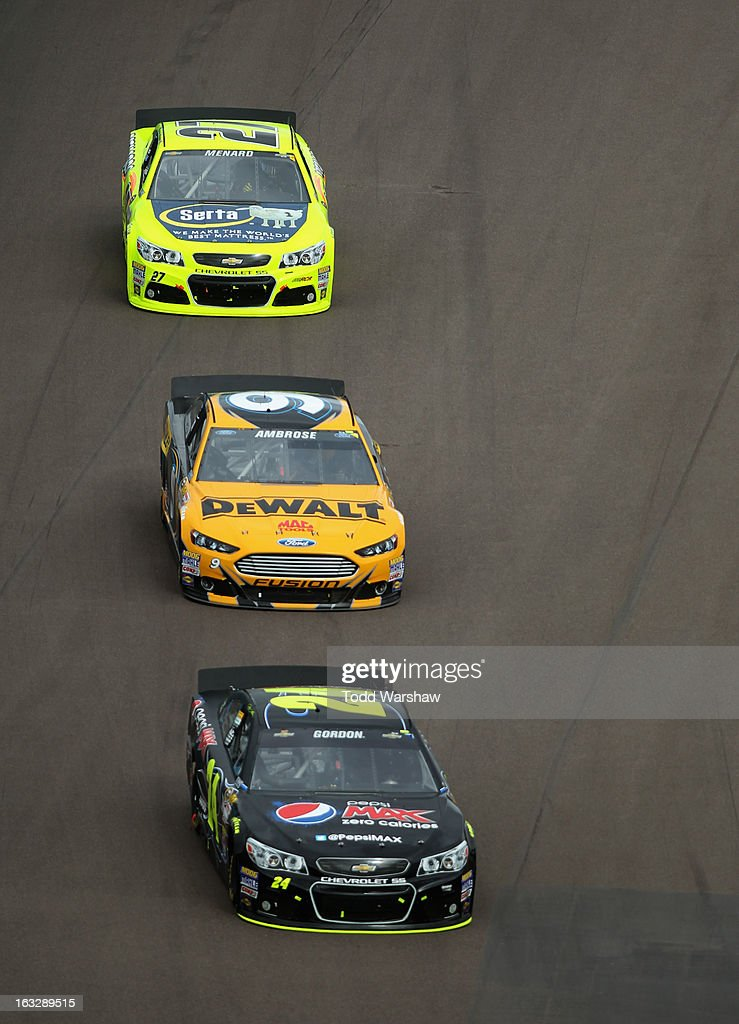Jeff Gordon driver of the Pepsi Max Chevrolet Marcos Ambrose driver of the DeWalt Ford and Paul Menard driver of the Menard's/Serta Chevrolet race...