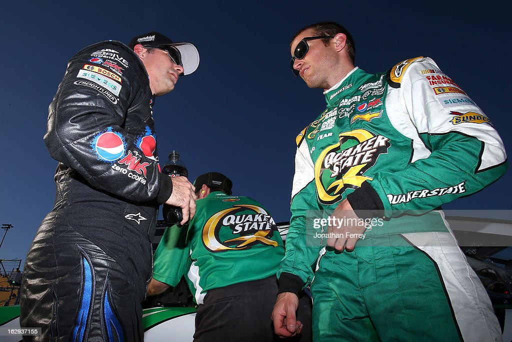 Jeff Gordon, driver of the #24 Pepsi Max Chevrolet, talks with Kasey Kahne, driver of the #5 Quaker State Chevrolet, on the grid during qualifying for the NASCAR Sprint Cup Series Subway Fresh Fit 500 at Phoenix International Raceway on March 1, 2013 in Avondale, Arizona.