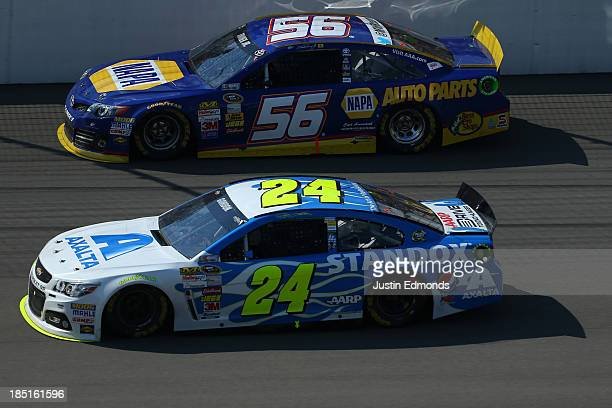 Jeff Gordon driver of the Standox Chevrolet and Martin Truex Jr driver of the NAPA Auto Parts Toyota during the NASCAR Sprint Cup Series 44th Annual...