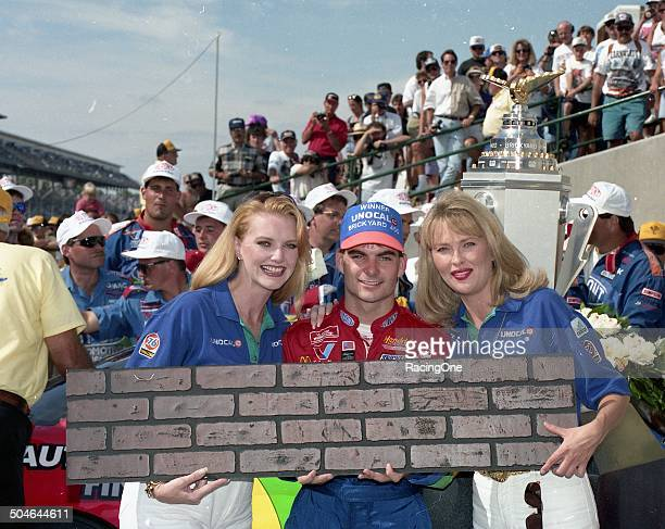 "Jeff Gordon gets his ""bricks"" after scoring the victory in the Brickyard 400 NASCAR Cup race on August 6 1994 at the Indianapolis Motor Speedway in..."