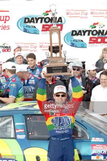 Jeff Gordon of DuPont Chevrolet Monte Carlo hoist his trophy as he celebrates winning the NASCAR Daytona 500 at Daytona International Speedway on...