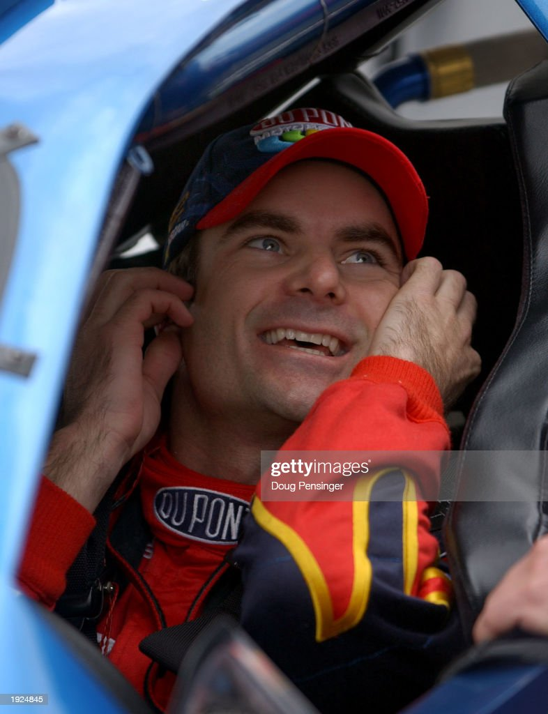 <a gi-track='captionPersonalityLinkClicked' href=/galleries/search?phrase=Jeff+Gordon&family=editorial&specificpeople=171491 ng-click='$event.stopPropagation()'>Jeff Gordon</a> smiles from inside his #24 DuPont Chevrolet after winning the pole position for the NASCAR Winston Cup Virginia 500 on April 11, 2003 at the Martinsville Speedway in Martinsville, Virginia.