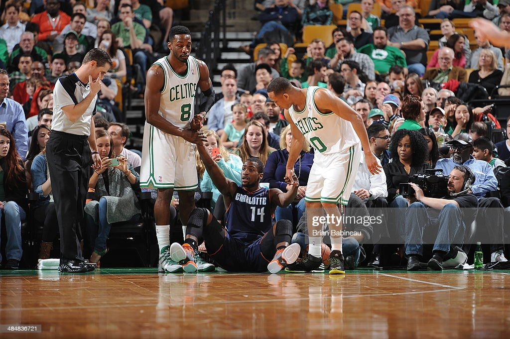 Jeff Green #8 and <a gi-track='captionPersonalityLinkClicked' href=/galleries/search?phrase=Avery+Bradley&family=editorial&specificpeople=5792051 ng-click='$event.stopPropagation()'>Avery Bradley</a> #0 of the Boston Celtics help up <a gi-track='captionPersonalityLinkClicked' href=/galleries/search?phrase=Michael+Kidd-Gilchrist&family=editorial&specificpeople=8526214 ng-click='$event.stopPropagation()'>Michael Kidd-Gilchrist</a> #14 of the Charlotte Bobcats on April 11, 2014 at the TD Garden in Boston, Massachusetts.