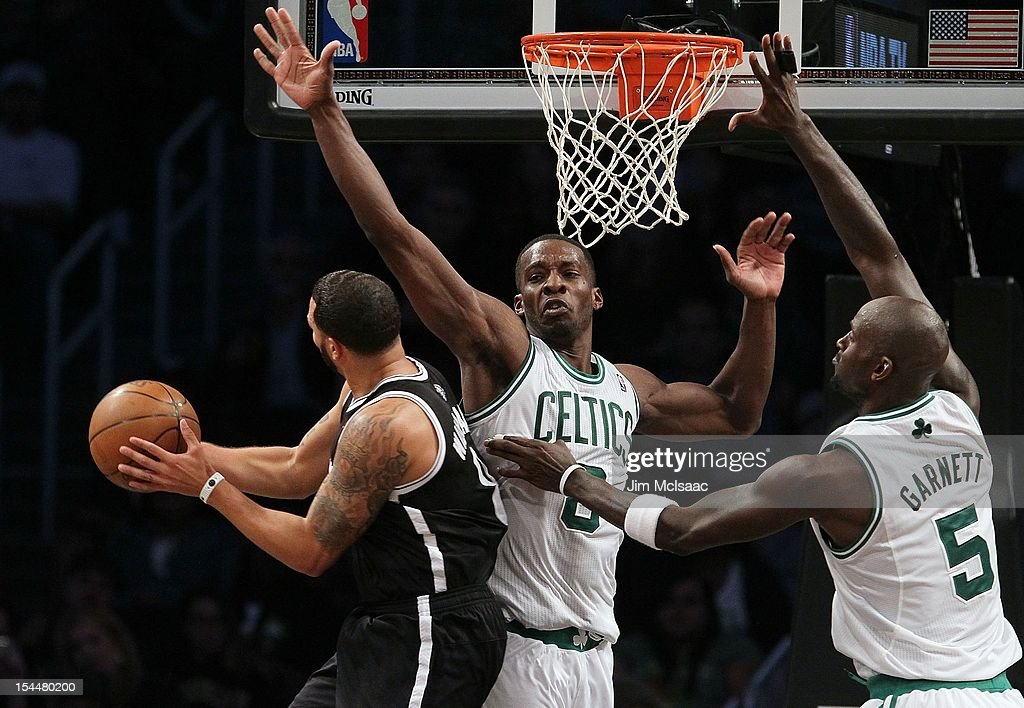 Jeff Green #8 and Kevin Garnett #5 of the Boston Celtics defend against Deron Williams #8 of the Brooklyn Nets during a preseason game at the Barclays Center on October 18, 2012 in the Brooklyn borough of New York City. The Celtics defeated the Nets 115-85.