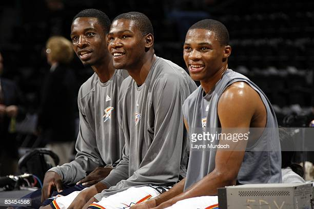 Jeff Green Kevin Durant and Russell Westbrook of the Oklahoma City Thunder look on during warmups prior to a preseason game against the Los Angeles...