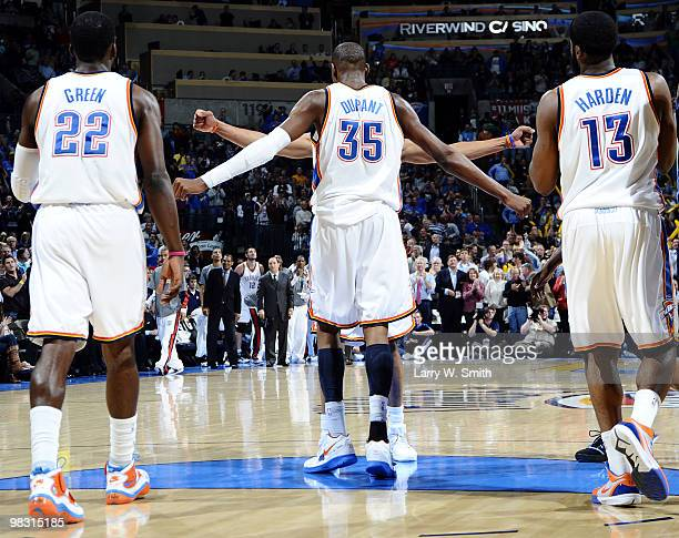 Jeff Green Kevin Durant chest bumping Russell Westbrook 30 and James Harden of the Oklahoma City Thunder pause during action against the Denver...