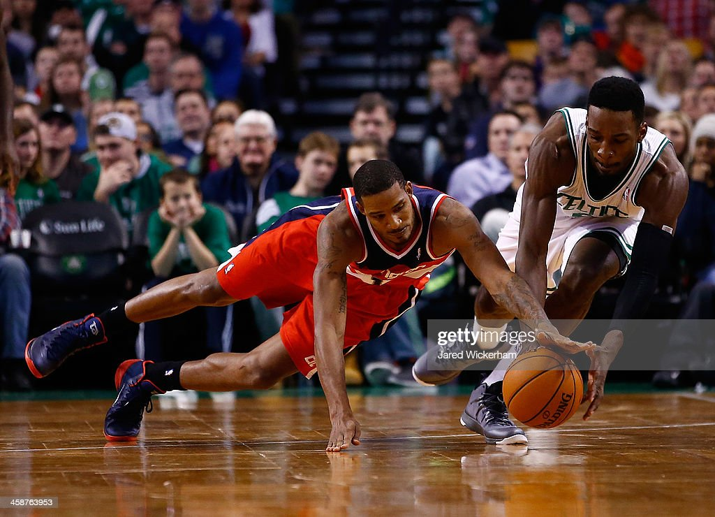 Jeff Green #8 of the Boston Celtics and Trevor Ariza #1 of the Washington Wizards scrambles for a loose ball in the second half during the game at TD Garden on December 21, 2013 in Boston, Massachusetts.