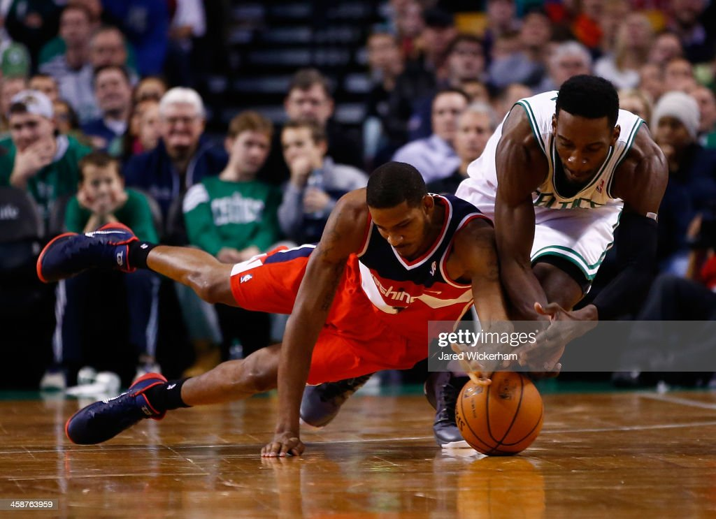 Jeff Green #8 of the Boston Celtics and <a gi-track='captionPersonalityLinkClicked' href=/galleries/search?phrase=Trevor+Ariza&family=editorial&specificpeople=201708 ng-click='$event.stopPropagation()'>Trevor Ariza</a> #1 of the Washington Wizards scrambles for a loose ball in the second half during the game at TD Garden on December 21, 2013 in Boston, Massachusetts.
