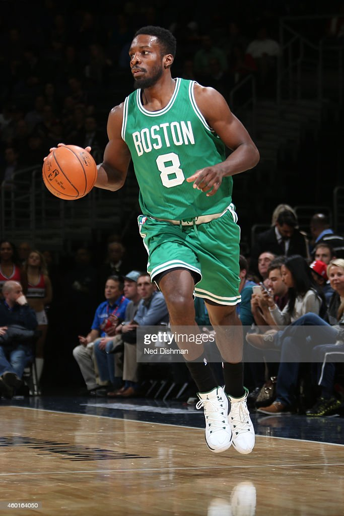 Jeff Green #8 of the Boston Celtics brings the ball up court against the Washington Wizards on December 8, 2014 at the Verizon Center in Washington, DC.