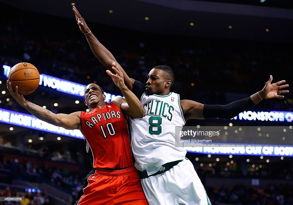 Jeff Green #8 of the Boston Celtics defends a layup by DeMar DeRozan #10 of the Toronto Raptors in the second half during the game at TD Garden on January 15, 2014 in Boston, Massachusetts.