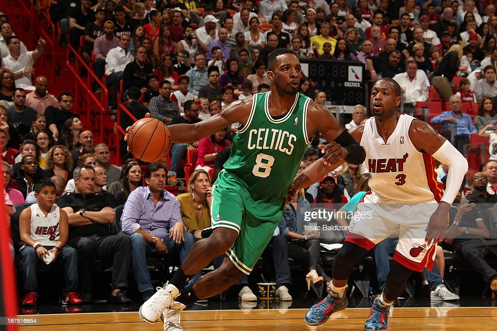 Jeff Green #8 of the Boston Celtics drives against Dwyane Wade #3 of the Miami Heat on November 9, 2013 at American Airlines Arena in Miami, Florida.