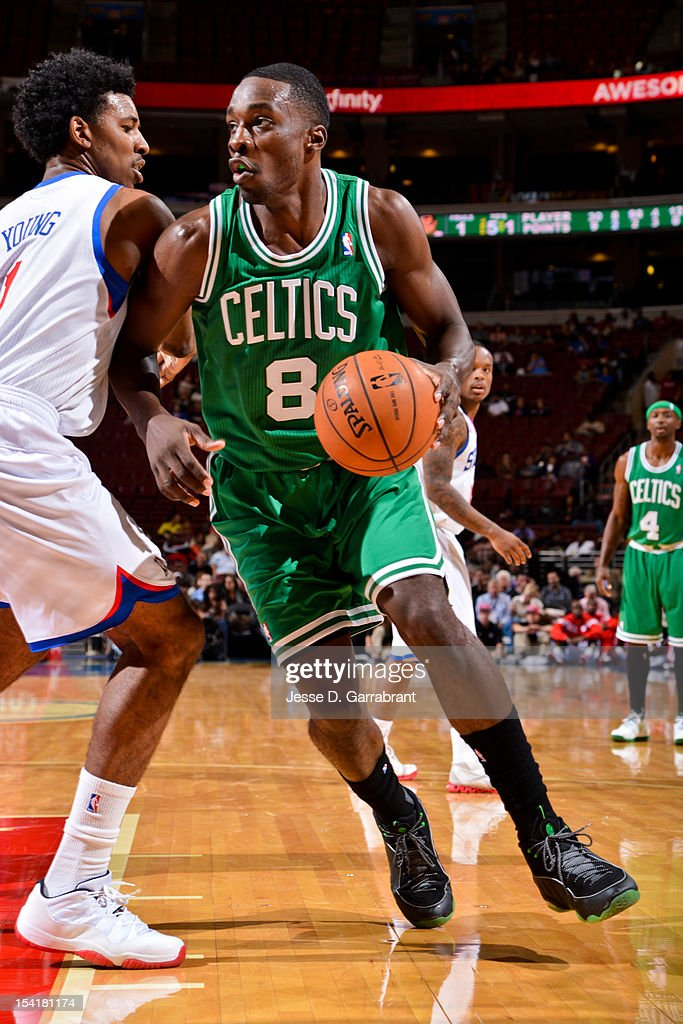 Jeff Green #8 of the Boston Celtics drives against Nick Young #1 of the Philadelphia 76ers during a pre-season game at the Wells Fargo Center on October 15, 2012 in Philadelphia, Pennsylvania.