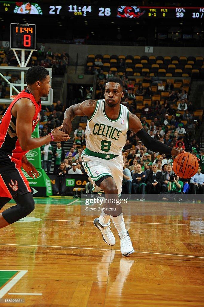 Jeff Green #8 of the Boston Celtics drives the ball against the Toronto Raptors on October 7, 2013 at the TD Garden in Boston, Massachusetts.