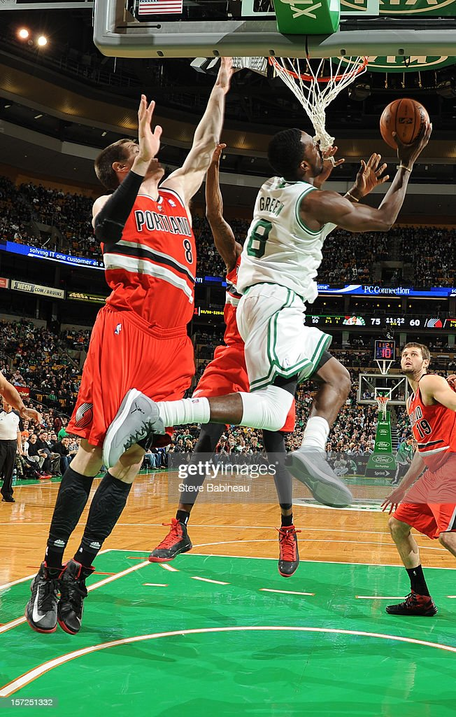 Jeff Green #8 of the Boston Celtics drives to the basket Luke Babbitt #8 of the Portland Trail Blazers on November 30, 2012 at the TD Garden in Boston, Massachusetts.