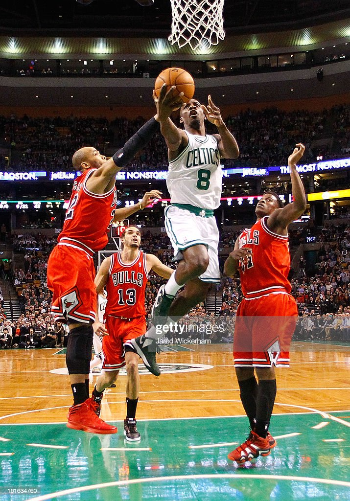 Jeff Green #8 of the Boston Celtics drives to the basket past Taj Gibson #22 of the Chicago Bulls before being fouled during the game on February 13, 2013 at TD Garden in Boston, Massachusetts.