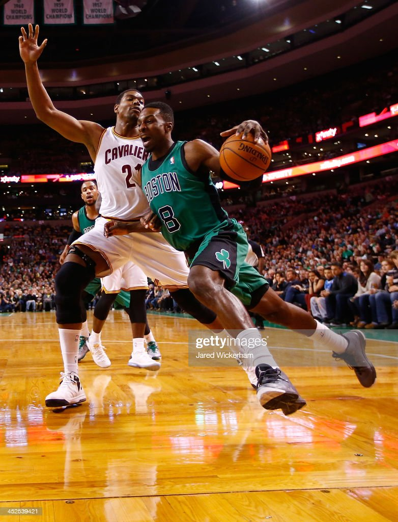 Jeff Green #8 of the Boston Celtics drives underneath the basket past Andrew Bynum #21 of the Cleveland Cavaliers in the first quarter during the game at TD Garden on November 29, 2013 in Boston, Massachusetts.