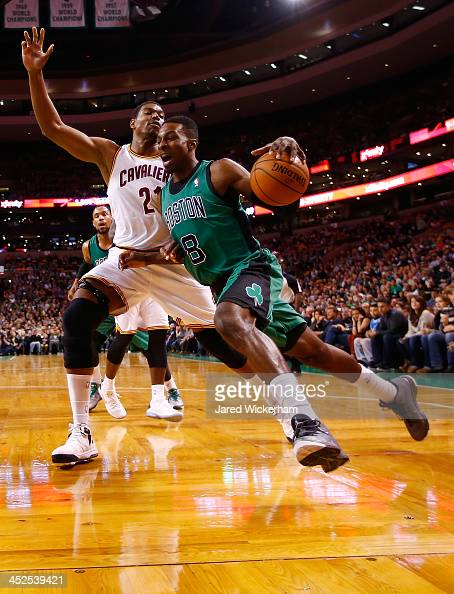 Jeff Green of the Boston Celtics drives underneath the basket past Andrew Bynum of the Cleveland Cavaliers in the first quarter during the game at TD...