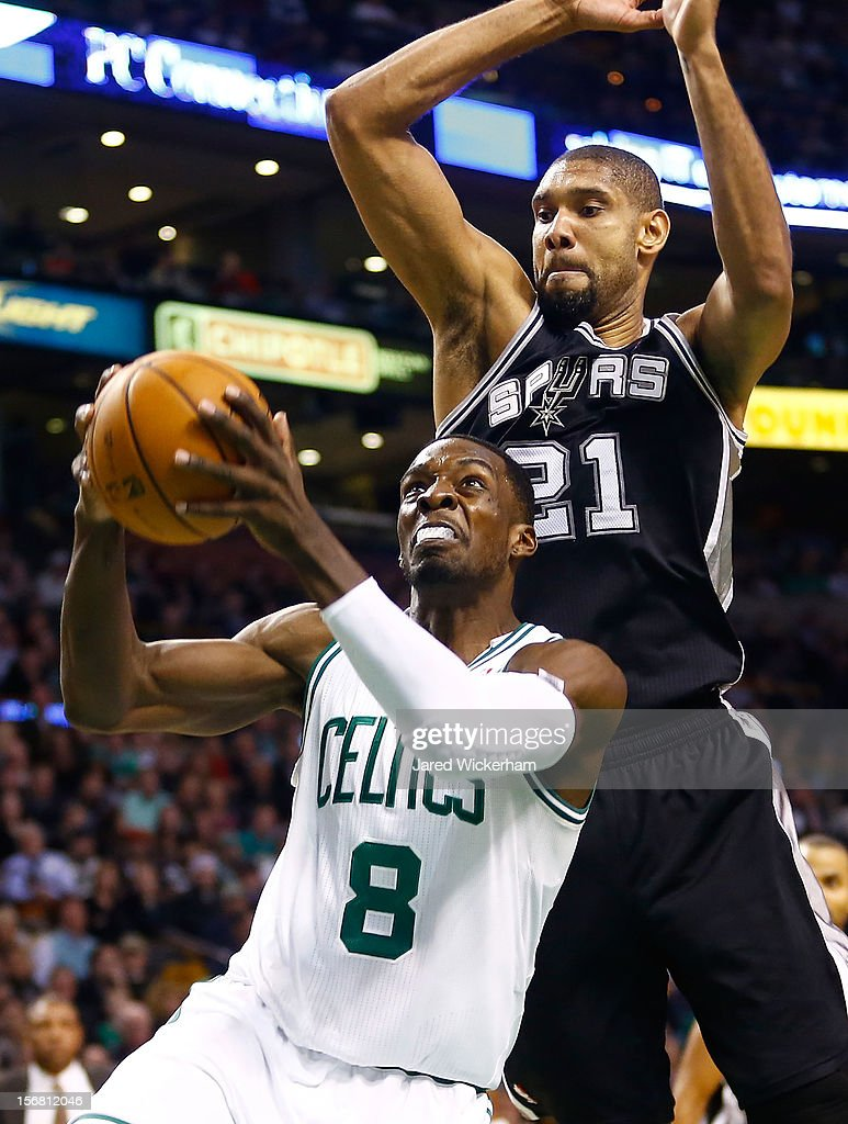 Jeff Green #8 of the Boston Celtics drives underneath Tim Duncan #21 of the San Antonio Spurs during the game on November 21, 2012 at TD Garden in Boston, Massachusetts.