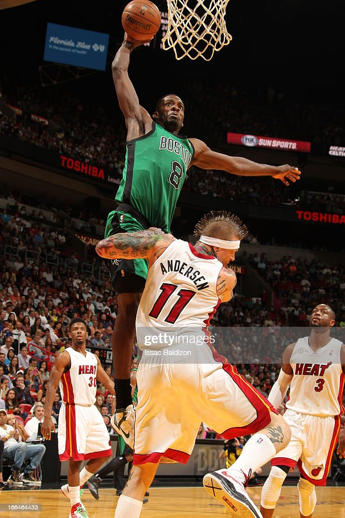 Jeff Green #8 of the Boston Celtics dunks against Chris Andersen #11 of the Miami Heat on April 12, 2013 at American Airlines Arena in Miami, Florida.