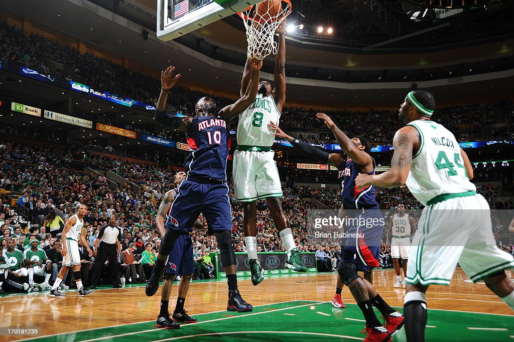 Jeff Green #8 of the Boston Celtics dunks against <a gi-track='captionPersonalityLinkClicked' href=/galleries/search?phrase=Johan+Petro&family=editorial&specificpeople=564344 ng-click='$event.stopPropagation()'>Johan Petro</a> #10 of the Atlanta Hawks on March 29, 2013 at the TD Garden in Boston, Massachusetts.