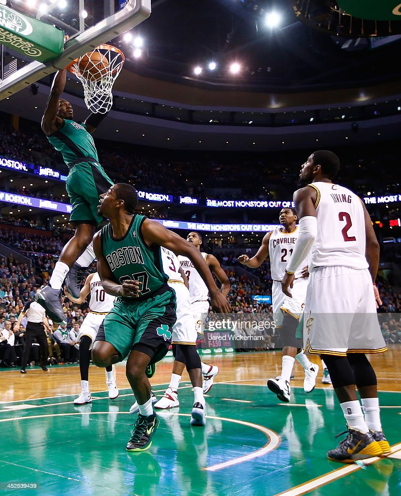 Jeff Green #8 of the Boston Celtics dunks an alley-oop from teammate <a gi-track='captionPersonalityLinkClicked' href=/galleries/search?phrase=Jordan+Crawford&family=editorial&specificpeople=4779380 ng-click='$event.stopPropagation()'>Jordan Crawford</a> #27 against the Cleveland Cavaliers in the first quarter during the game at TD Garden on November 29, 2013 in Boston, Massachusetts.