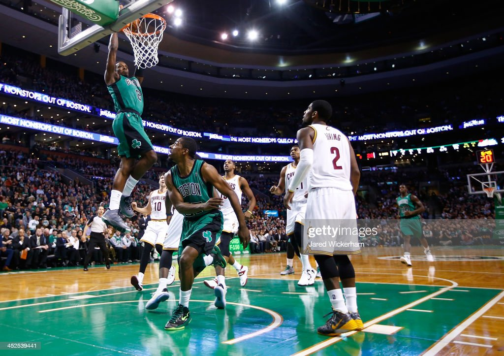 Jeff Green #8 of the Boston Celtics dunks an alley-oop from teammate Jordan Crawford #27 against the Cleveland Cavaliers in the first quarter during the game at TD Garden on November 29, 2013 in Boston, Massachusetts.