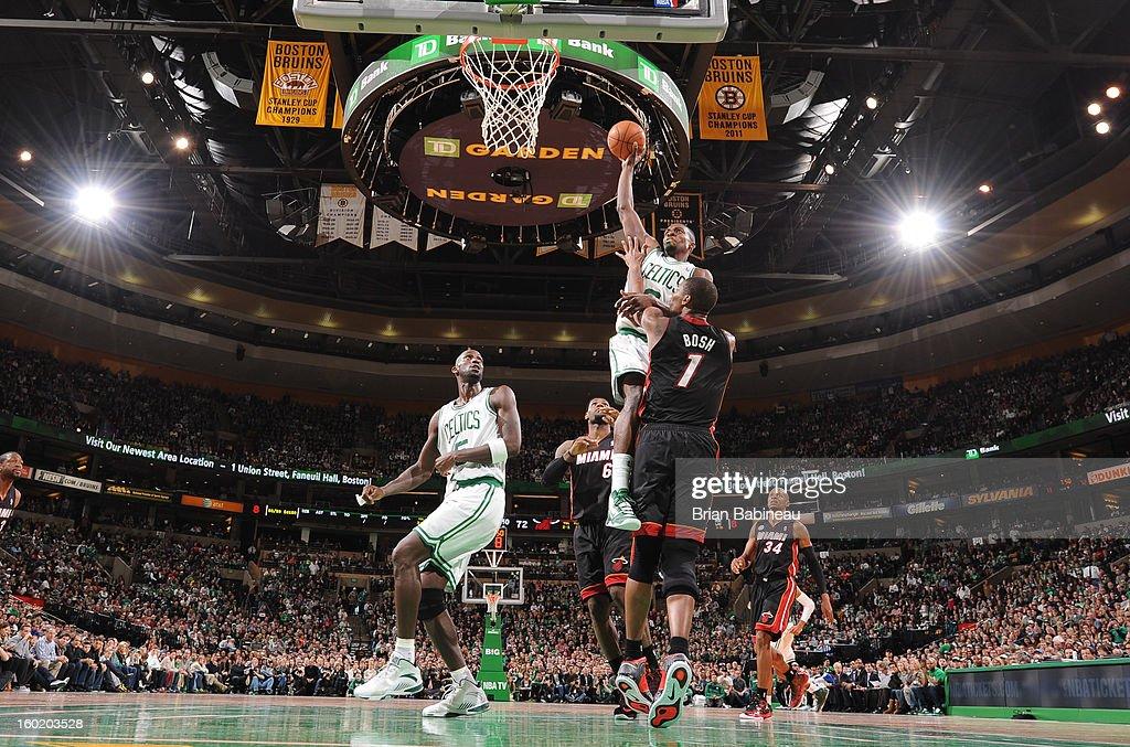 Jeff Green #8 of the Boston Celtics dunks the ball against Chris Bosh #1 of the Miami Heat on January 27, 2013 at the TD Garden in Boston, Massachusetts.