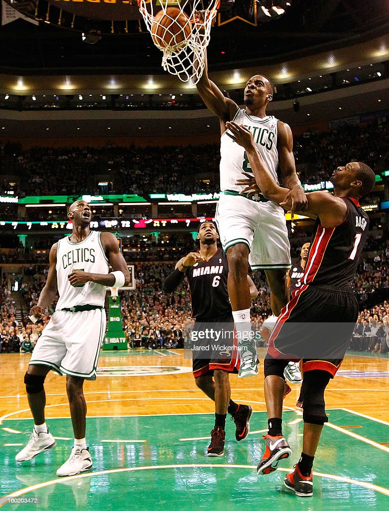 Jeff Green #8 of the Boston Celtics dunks the ball over Chris Bosh #1 of the Miami Heat during the game on January 27, 2013 at TD Garden in Boston, Massachusetts.