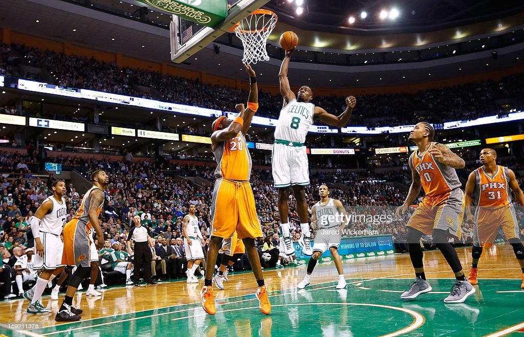 Jeff Green #8 of the Boston Celtics dunks the ball over Jermaine O'Neal #20 of the Phoenix Suns during the game on January 9, 2013 at TD Garden in Boston, Massachusetts.