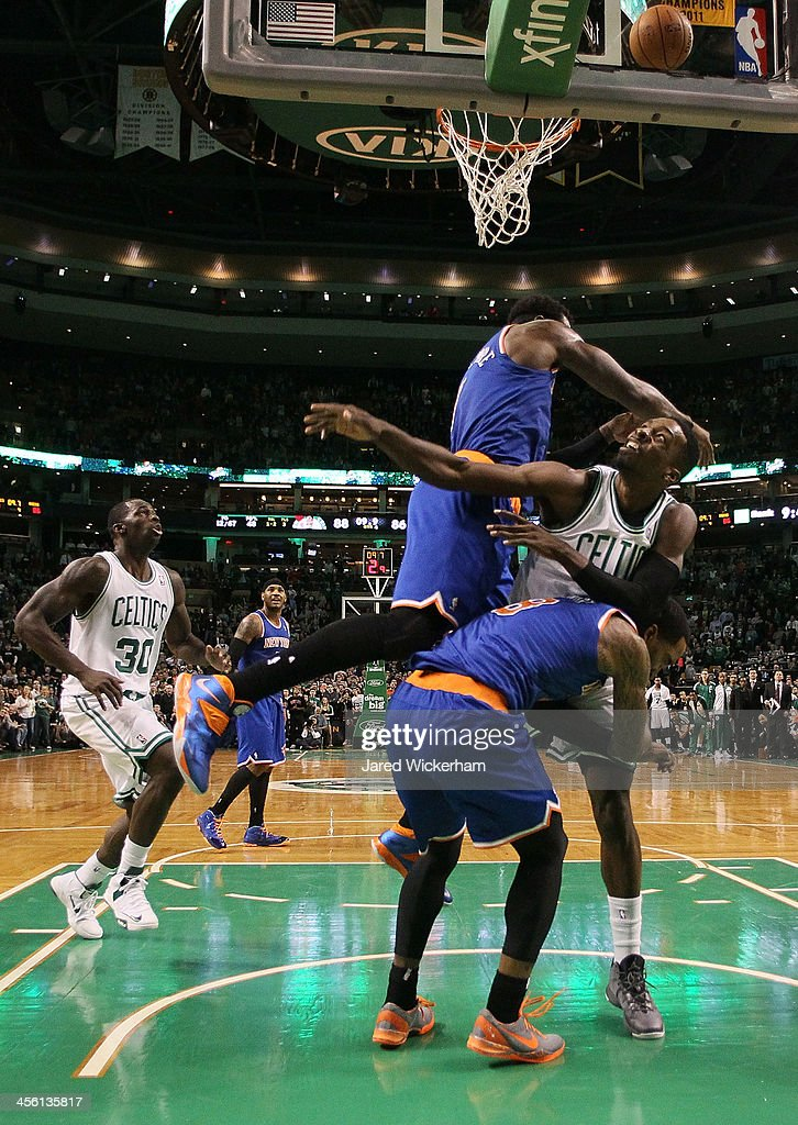 Jeff Green of the Boston Celtics gets fouled following a shot in front of Amar'e Stoudemire and JR Smith of the New York Knicks in the final seconds...