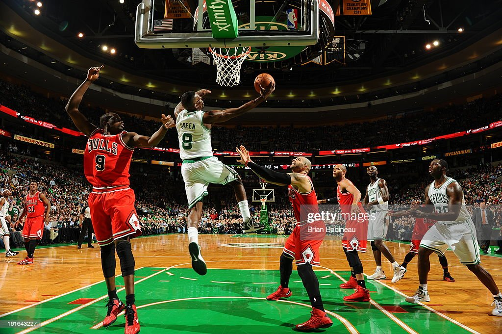 Jeff Green #8 of the Boston Celtics goes in for a reverse dunk against <a gi-track='captionPersonalityLinkClicked' href=/galleries/search?phrase=Luol+Deng&family=editorial&specificpeople=202830 ng-click='$event.stopPropagation()'>Luol Deng</a> #9 and <a gi-track='captionPersonalityLinkClicked' href=/galleries/search?phrase=Carlos+Boozer&family=editorial&specificpeople=201638 ng-click='$event.stopPropagation()'>Carlos Boozer</a> #5 of the Chicago Bulls on February 13, 2013 at the TD Garden in Boston, Massachusetts.