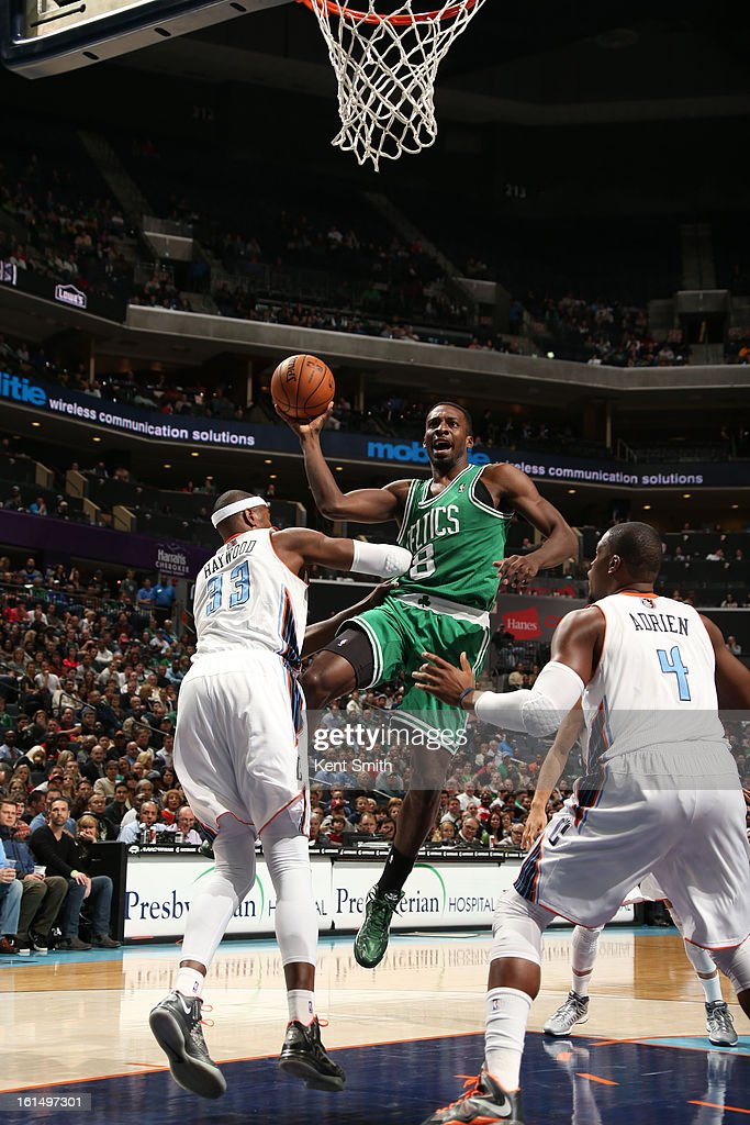 Jeff Green #8 of the Boston Celtics goes to the basket against Brendan Haywood #33 and Jeff Adrien #4 of the Charlotte Bobcats at the Time Warner Cable Arena on February 11, 2013 in Charlotte, North Carolina.