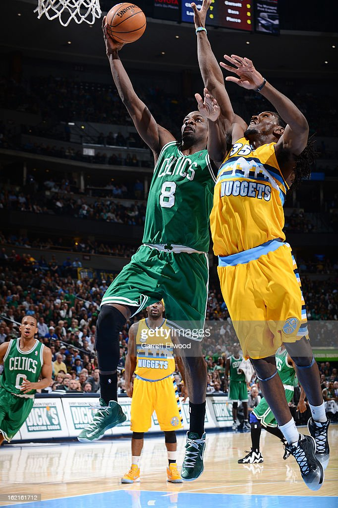 Jeff Green #8 of the Boston Celtics goes to the basket against Kenneth Faried #35 of the Denver Nuggets on February 19, 2013 at the Pepsi Center in Denver, Colorado.