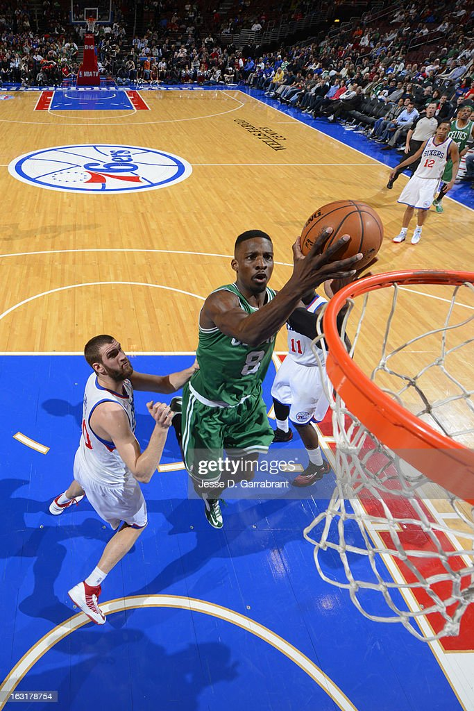 Jeff Green #8 of the Boston Celtics goes to the basket against Spencer Hawes #00 of the Philadelphia 76ers on March 5, 2013 at the Wells Fargo Center in Philadelphia, Pennsylvania.