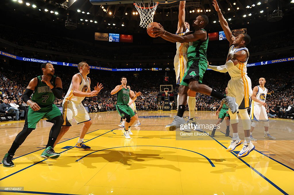 Jeff Green #8 of the Boston Celtics goes up for the shot against <a gi-track='captionPersonalityLinkClicked' href=/galleries/search?phrase=Andrew+Bogut&family=editorial&specificpeople=207105 ng-click='$event.stopPropagation()'>Andrew Bogut</a> #12 of the Golden State Warriors on January 10, 2014 at Oracle Arena in Oakland, California.