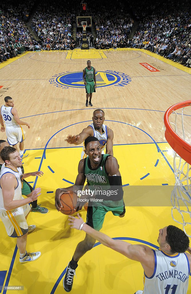 Jeff Green #8 of the Boston Celtics goes up for the shot against Klay Thompson #11 and Carl Landry #7 of the Golden State Warriors on December 29, 2012 at Oracle Arena in Oakland, California.