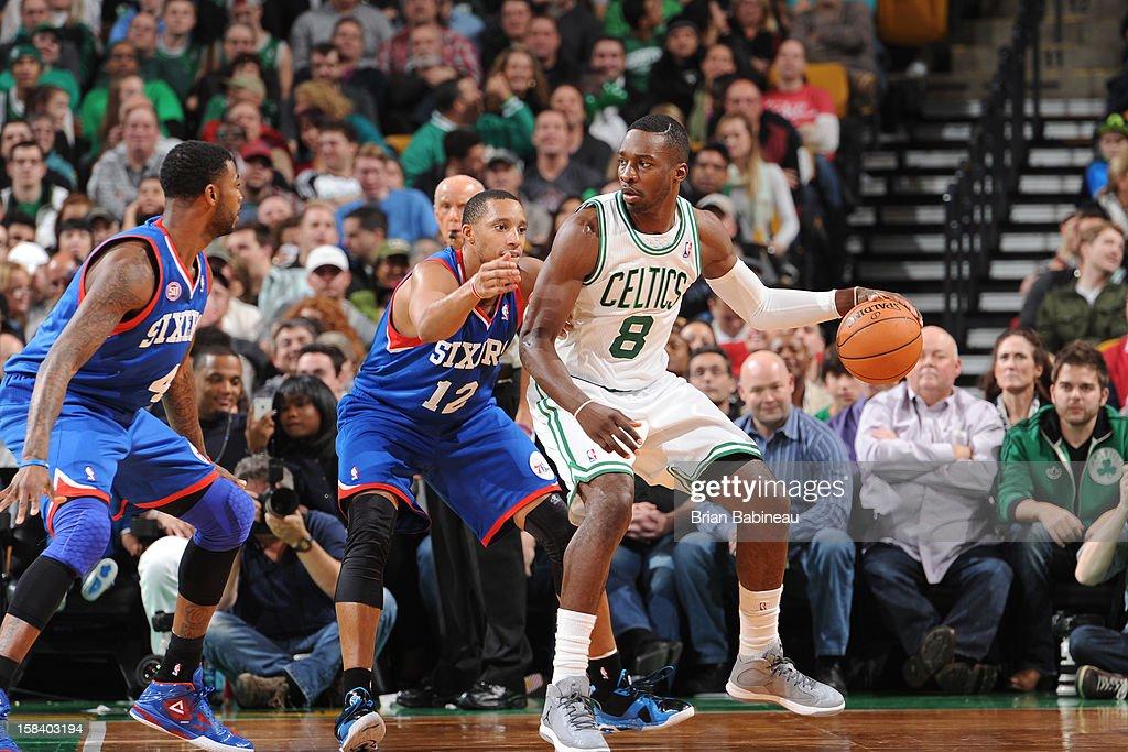 Jeff Green #8 of the Boston Celtics handles the ball against Evan Turner #12 of the Philadelphia 76ers on December 8, 2012 at the TD Garden in Boston, Massachusetts.