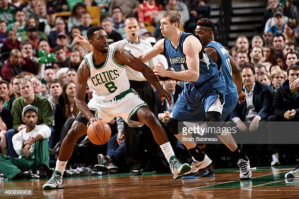 Jeff Green of the Boston Celtics handles the ball against Robbie Hummel of the Minnesota Timberwolves on December 19 2014 at the TD Garden in Boston...
