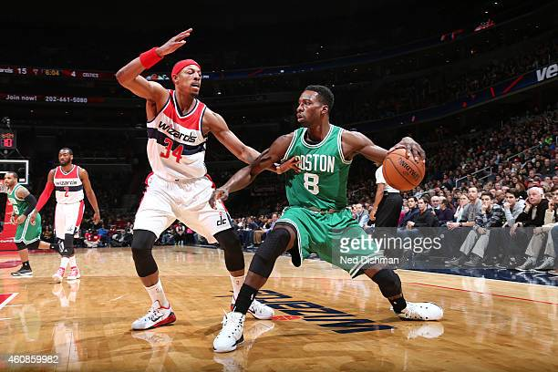 Jeff Green of the Boston Celtics looks to move the ball against Paul Pierce of the Washington Wizards during the game on December 27 2014 at Verizon...