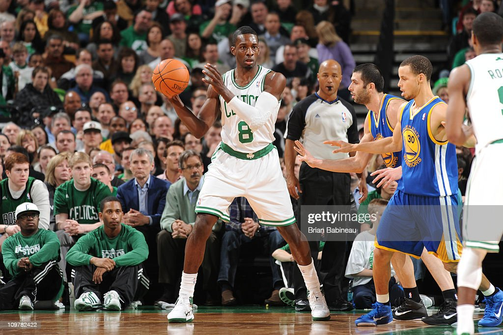Jeff Green #8 of the Boston Celtics looks to pass against <a gi-track='captionPersonalityLinkClicked' href=/galleries/search?phrase=Vladimir+Radmanovic&family=editorial&specificpeople=201834 ng-click='$event.stopPropagation()'>Vladimir Radmanovic</a> #77 of the Golden State Warriors on March 4, 2011 at the TD Garden in Boston, Massachusetts.