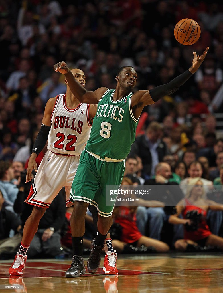 Jeff Green #8 of the Boston Celtics reaches for the ball in front of Taj Gibson #22 of the Chicago Bulls at the United Center on November 12, 2012 in Chicago, Illinois. The Celtics defeated the Bulls 101-95.