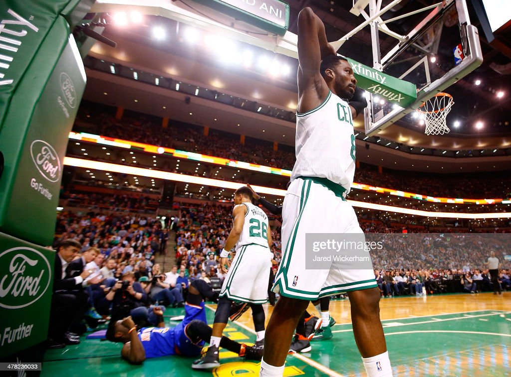 Jeff Green #8 of the Boston Celtics reacts following a foul against <a gi-track='captionPersonalityLinkClicked' href=/galleries/search?phrase=Tim+Hardaway&family=editorial&specificpeople=210592 ng-click='$event.stopPropagation()'>Tim Hardaway</a>, Jr #5 of the New York Knicks in the second quarter during the game at TD Garden on March 12, 2014 in Boston, Massachusetts.