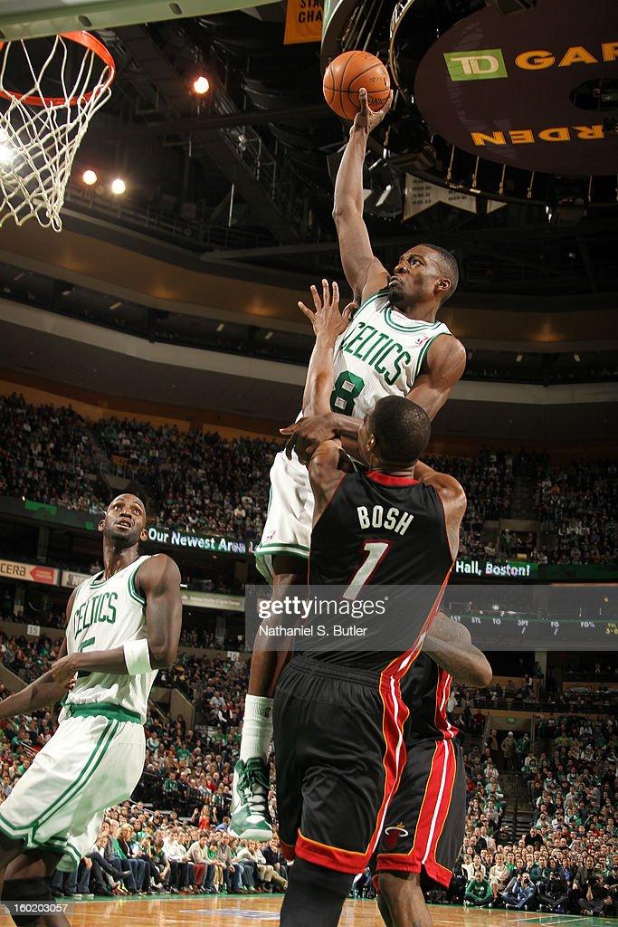 Jeff Green #8 of the Boston Celtics rises for a dunk against Chris Bosh #1 of the Miami Heat on January 27, 2013 at TD Garden in Boston, Massachusetts.