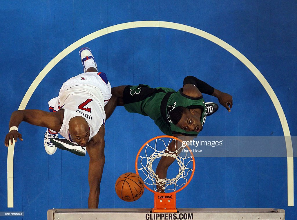 Jeff Green #8 of the Boston Celtics scores on a layup past <a gi-track='captionPersonalityLinkClicked' href=/galleries/search?phrase=Lamar+Odom&family=editorial&specificpeople=201519 ng-click='$event.stopPropagation()'>Lamar Odom</a> #7 of the Los Angeles Clippers during a 16-77 loss to the Clippers for 15 straight wins at Staples Center on December 27, 2012 in Los Angeles, California.