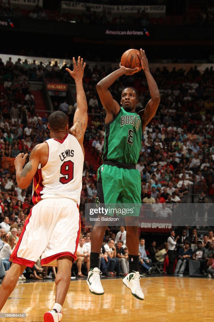 Jeff Green #8 of the Boston Celtics shoots a jumper against <a gi-track='captionPersonalityLinkClicked' href=/galleries/search?phrase=Rashard+Lewis&family=editorial&specificpeople=201713 ng-click='$event.stopPropagation()'>Rashard Lewis</a> #9 of the Miami Heat on April 12, 2013 at American Airlines Arena in Miami, Florida.