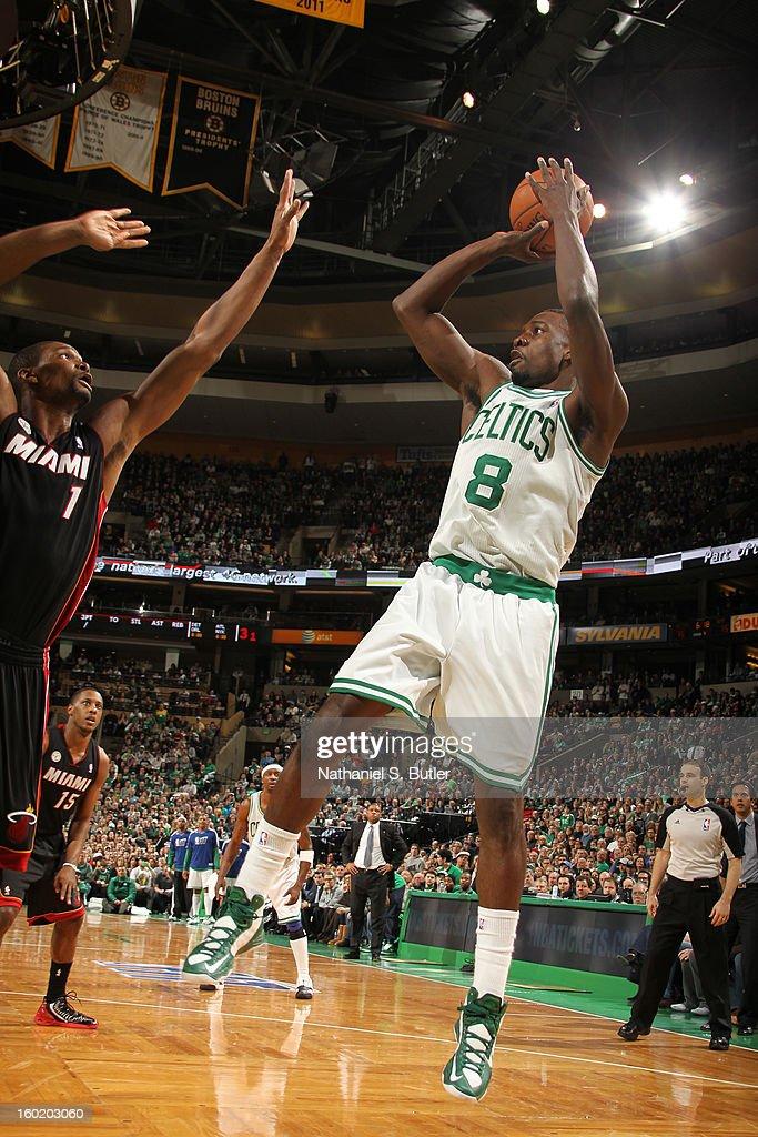Jeff Green #8 of the Boston Celtics shoots against Chris Bosh #1 of the Miami Heat on January 27, 2013 at TD Garden in Boston, Massachusetts.