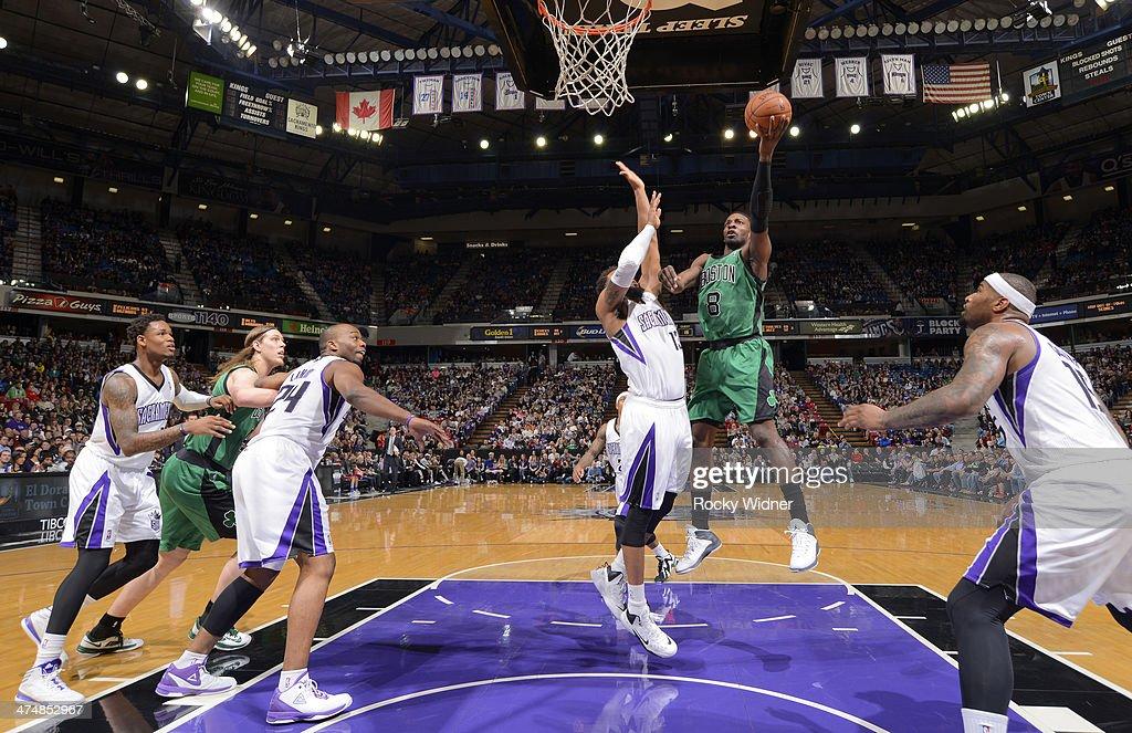 Jeff Green #8 of the Boston Celtics shoots against Derrick Williams #13 of the Sacramento Kings on February 22, 2014 at Sleep Train Arena in Sacramento, California.