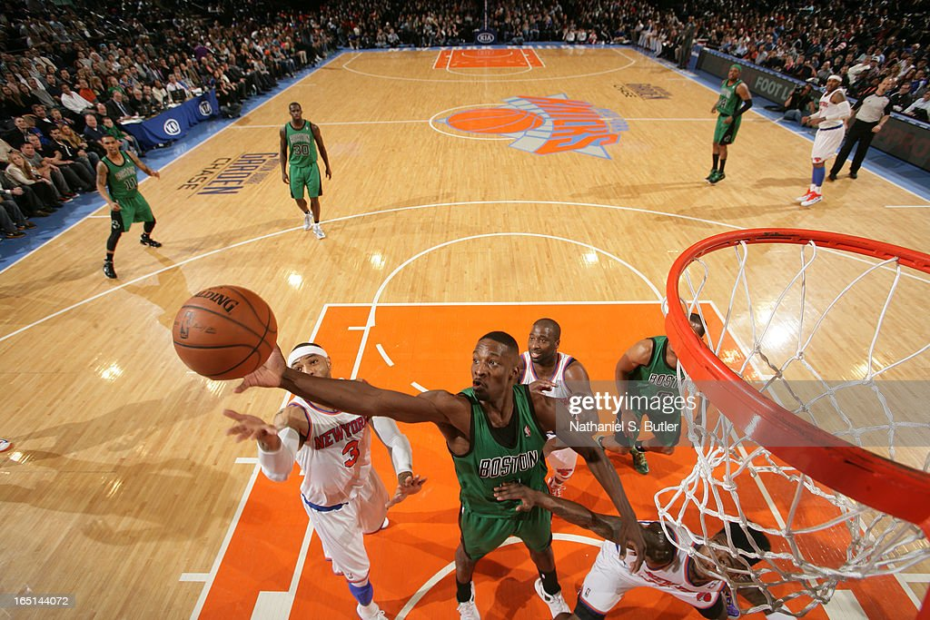 Jeff Green #8 of the Boston Celtics shoots against Kenyon Martin #3 and Iman Shumpert #21 of the New York Knicks on March 31, 2013 at Madison Square Garden in New York City.